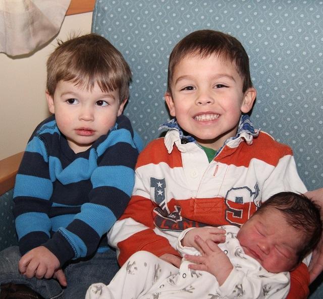 Kian Fleming's brothers holding him