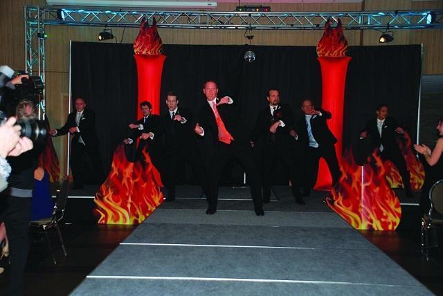 Bachelor for Hope bachelors performing a dance