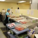 TBRHSC cafeteria worker preparing food