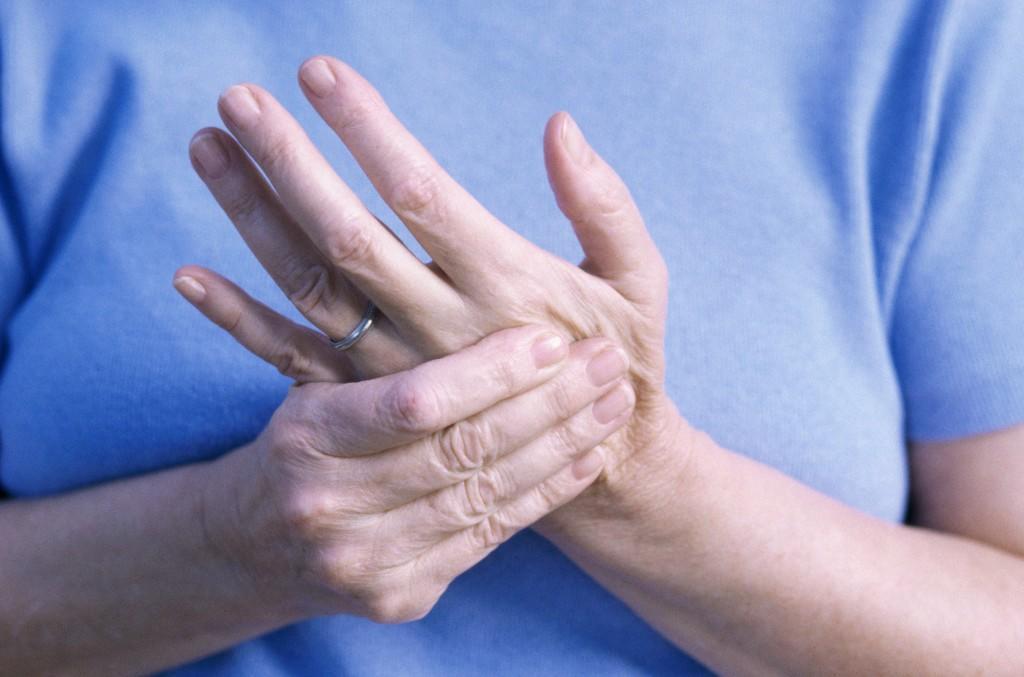 Woman massaging her hand