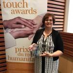 Debora Prokopich Buzzi receiving the Human Touch Award