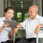 Nurse discussing over digital tablet